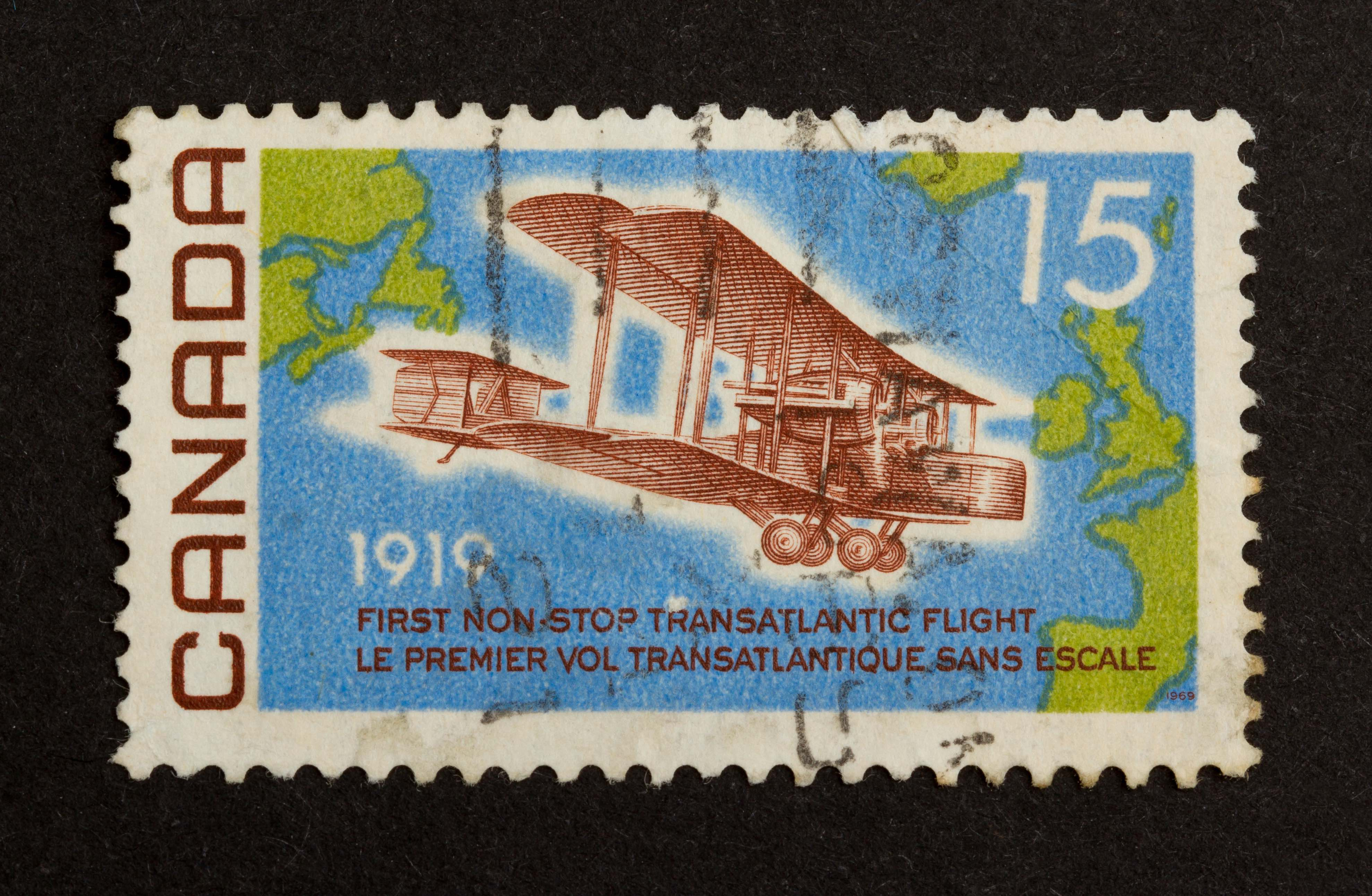CANADA - CIRCA 1980: Stamp printed in Canada shows a world map and a airplane (1919), circa 1980
